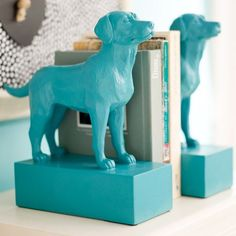 DIY bookends< cheap plastic toy spray painted, wood block spray paint it, dry and hot glue toy on block