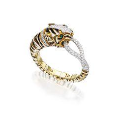 18 KARAT GOLD, PLATINUM, DIAMOND, EMERALD AND ENAMEL BANGLE-BRACELET, DAVID WEBB Designed as a tiger highlighted by black and white enamel s...