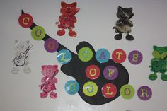 """Cutout letters & Guitars to cover our """"Color Cats"""" who are originally holding paintbrushes and an sketchpad. Used Cricut gypsy to cut letters and guitars."""