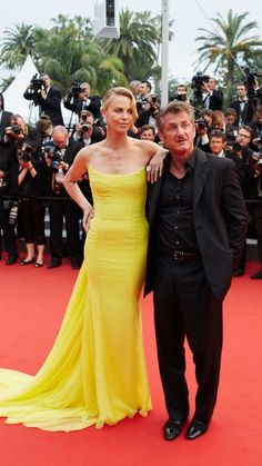 Charlize Theron in Dior Couture with Sean Penn at Cannes Film Festival 2015. See all the red carpet looks at Redonline.co.uk