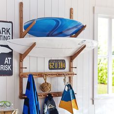 Nice, multi-function surf board rack for home, porch or garage. I found mine here: https://api.shopstyle.com/action/apiVisitRetailer?id=475183917&pid=uid6961-33445719-94