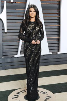 Selena Gomez wearing a long sleeve black lace Louis Vuitton gown at the 2015 Vanity Fair Oscar After-Party