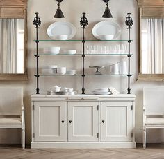 Inspiration -- use bottom of current china cabinet, remove top hutch and add industrial pipe and glass shelving -- install lights to shine through the glass shelves.