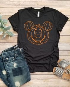 Mickey Pumpkin T-Shirt This t-shirt is Made To Order, one by one printed so we can control the quality. Disney Halloween Shirts, Mickey Halloween, Theme Halloween, Disney Shirts, Disneyland Halloween, Disney Clothes, Halloween Ideas, Halloween Costumes, Disney World Outfits