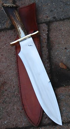 "Commande client Reproduction du bowie film SERAPHYM FALL , lame de 30.7 cm forgé en Xc 75 avec trempe selective , hors tout de 47 cm , garde laiton et manche en sambarg stag Customer's order , reproduction of bowie knife movie SERAPHYM FALLS , blade of 12.09"" forged in 0.75 carbon steel with selective temper , oal of 18.5"" , brass guard , sambarg stag handle www.aufildelalame.fr"