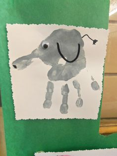 """For zoo week we made these cute elephant hand prints. I covered my door and wrote on the window """"Its a zoo in preschool!"""""""