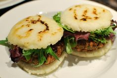 Arepas - A staple of any Venezuelan's diet. :) You can stuff them with anything. I prefer queso fresco with ham.