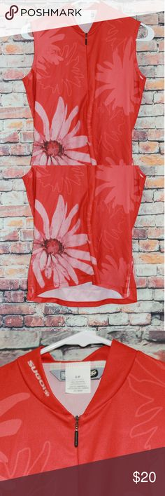 Sugoi Cycling Jersey Floral design. Three rear pockets, half zip. Good condition sugoi Tops Tank Tops