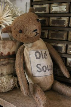 "An ""Old Soul"" Bear , made by me...Dru Ann Jeffries. Part of my Cinnamon Creek Line - This sweet fella is fitting for any one - any age !   He is made with very distressed plush felt and canvas. Stuffed with cotton and rags.  This Bear... ""Dash"" - sits at 11'' high  My bears are primitively made. I do not joint the parts together, I simply sew them all together by hand. Although they are not jointed, you can reposition them somewhat. ♥ SOLD  1 of 2"