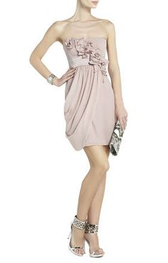 Emily Strapless Dress With Rosettes $368 Straight neck. Strapless. Pleating detail at bodice. Pintuck detail banded waist. Draped detail from front to center back. Concealed center back zipper with hook-and-eye closure.