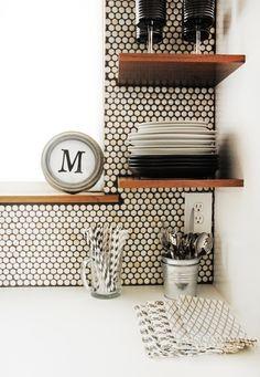 white penny-round backsplash and wooden shelves