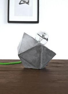 The Lightblokk.    This cubistic lamp is made from gray concrete. It combines a minimalistic form factor with rough concrete into a timeless design.
