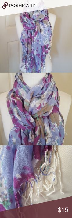 Flowered scarf Periwinkle blue background with a floral pattern in magenta, tan, black, white and spots of green. Fringed tassels on the ends. Great condition. Accessories Scarves & Wraps