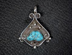 "Elegant Turquoise Pendant by Legendary Navajo artisan, James Little. Gorgeous Kingman Turquoise Stone set in Sterling Silver. This is his early work before he started working more with gold. This high quality piece would be a great addition to your collection. His jewelry is a reflection of the beauty around him. Signed with James's hallmark, the letter's JL inside an arrowhead Measures 1 3/4"" tall by 1 3/8"" wide. by FarRiderWest on Etsy"