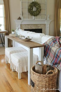 A reclaimed top, and simple straight legs allow for sliding stools offering extra seating under this creative sofa table from City Farmhouse.  A Terrible Space to Waste blog - DesigNich Creations