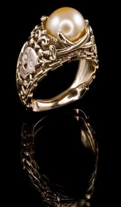 Yellow South Sea pearl and white diamonds made into a beautifully crafted pirate style ring.