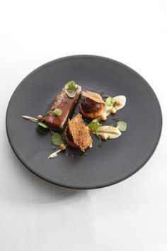 Roasted saddle of lamb breaded with cashew nut, braised shoulder, fried chickpeas and crispy socca