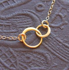Tiny gold entwined rings circles necklace by jersey608jewelry, $24.00
