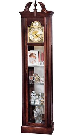 Howard Miller Cherish 610-614 Curio Grandfather Clock The Howard Miller Cherish is a tall, but smaller footprint curio floor clock that will display your collectables in fashion.