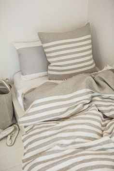 Camille has clear, crisp lines and a slubby, textured fabric. The design is a grey/flax base with oyster stripes. The pillow covers are finished with a zipper closure. Pillows, Bedding Collections, Sheets, Classic Linen, Pillow Cushion, Pillow Covers, Linen Duvet, Linen, Room Interior