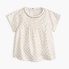 A soft, lightweight cotton makes this vacation-ready shirt extra breezy, while sparkly gold polka dots make it extra special (and cute!).  <ul><li>Cotton.</li><li>Machine wash.</li><li>Import.</li></ul>