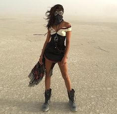 Burning man... I love the dress she's wearing! I'd personally pair it with bare foot sandlots.. but inly if it wasn't burning man!