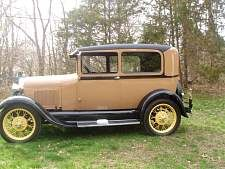 "1929 Ford Model A Sedan. My dad had this car in high school. His had all kind of paint colors on it and he wrote ""leapin Lena"" across it (my grandmas name)."