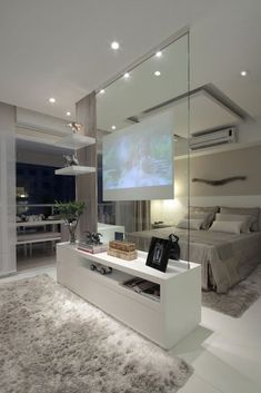 Modern contemporary luxury white master bedroom with TV inside a glass panel ! Sexy, cool and wonderful! Double bedroom dream house luxury home house rooms bedroom furniture home bathroom home modern homes interior penthouse Dream Home Design, Home Interior Design, House Design, Luxury Interior, Interior Ideas, Interior Modern, Scandinavian Interior, Interior Doors, Interior Paint