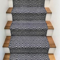 "We DIY'ed this stair runner in ONE afternoon & I posted a quick tutorial if you're looking to give your stairs some TLC without spending lots of $$$.  It's linked in my bio under Blog. I am by no means a blogger, but ""crappy write ups on DIY stuff"" just doesn't have the same ring to it. Amiright?"
