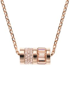 Michael Kors Rose-Gold Tone Pave Barrel Pendant Necklace.  This chic Michael Kors necklace adds a modern touch to any ensemble. A rose-gold tone chain displays a barrel pendant at the center | #jewelry #pendant #necklace #michaelkors #gift #anniversary #birthday