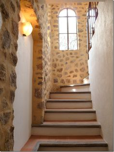 The staircase is made of stone, stucco and terracotta tiles.