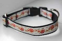 Handmade collars for your beautiful dogs, made of thick black strap, 20 mm width, with unique applications. Closure with plastic trident and D ring of thick metal. The maximum adjustable length is 34 cm.