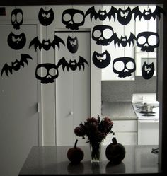 Halloween version of snowflakes.  Use black construction paper; cut out bats, owls, skulls, cats, etc. and string together. Fun to hang in window