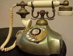 DESCRIPTION Vintage Victorian Rotary Telephone - Decorative accent for your home. - Vintage French-style cradle phone; dated July 1968. - Beautiful tarnished, brass base. - Dark brass and ivory-colore