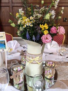 This was a lovely Easter wedding full of flowers reflecting the pastel colours of Cadbury mini eggs with jars of mini eggs on the tables for the guest #easterwedding #sringflowers #muscari #lisianthus #daisy #narcissi #cadburymini #jugofflowers #pennyjohnsonflowers  #daffodils #tanecetum #Daisy  #gypsophila #springwedding #yellowthemewedding #easterwedding #justpickedflowers #bridalbouquet #warwickshieflorist #birminghamflorist