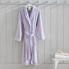 Stay snug and warm in this supersoft spa Lilac Bath Robe. Featuring a lavender sachet, this comfy robe exudes relaxing vibes.  Pottery Barn Teen Sonoma Lavender Bath Robe