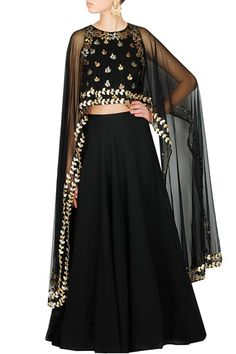 Featuring a black cape style blouse with gota patti work all over paired with a flared georgette skirt with can can underneath. 	Fabric: Crepe, Georgette,net 	Care Instructions: Dry clean only. … Continue reading →