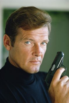 Roger Moore as James Bond in a publicity still for the film 'Live and Let Die', Dec. 1972. Moore died Tuesday at age 89. Terry O'Neill/Getty Images