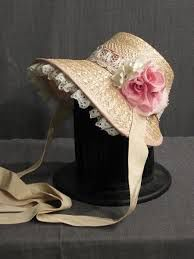 Image from http://www.osfcostumerentals.org/stock/Accessories/Hats/Women's%20Hats/Women's%2019th%20Century/slides/11002152%20Bonnet%20Womens%2019th%20Century%20Pink%20Ribbon%20-%20Straw.JPG.