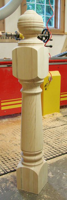 A Windsor newel post turned by Century Porch Post Inc.