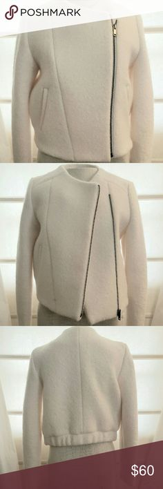 Banana Republic Creme Boucle Jacket size 6P NWOT Brand new without tags Banana Republic cropped cream boucle jacket. Zipper front. Fully lined. Side Pockets. Jacket comes to just above waistline. Very warm. Looks great with cocktail dress, jeans, or business attire. Size 6 petite. Dry clean. Banana Republic Jackets & Coats