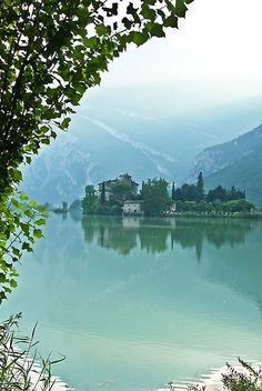 Castle Toblino rises from Lake Toblino, Trento, Italy