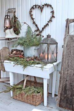 VIBEKE DESIGN I know this is a Christmas vingnette, however the heart pinecone wreath would be adorable on the door for Vday.