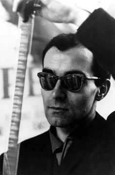 "Jean Luc Godard - Director / screenwriter from the French film movement La Nouvelle Vague, or ""New Wave"" Famous Directors, French New Wave, Fritz Lang, Jean Luc Godard, French Movies, Trending Sunglasses, Iconic Movies, Great Films, Film Director"