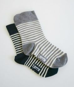 Tjerrie baby bamboo socks. Pinstripes in grey/white and navy/ white. Hypo allergenic for sensitive baby skin. Bamboo for my babba!