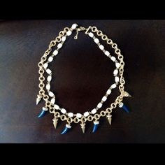 Bauble bar statement necklace Safari style baublebar necklace. Beautiful blue horns contrasting with white beads. Worn once, looks brand new Bauble bar Jewelry Necklaces