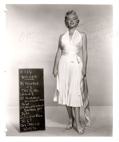 Marilyn Monroe in a white pleated halter dress for costume fitting for 'Seven Year Itch'