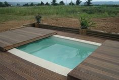 Abri-de-piscine-plat-bois-DECKEO Plus