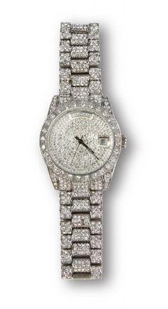 A silver tone, faux diamond encrusted analog wristwatch worn by Denzel Washington in Training Day.