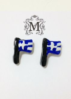 """Show your Grecian pride with these handcrafted polymer clay stud earrings! Measuring at about 3/4"""" each earring is coated with a protective sealant for a beautiful and durable shine."""